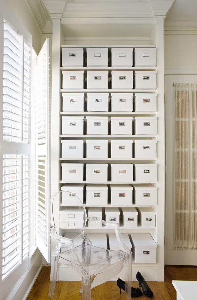 Inspiration for a transitional medium tone wood floor closet remodel in DC Metro with open cabinets and white cabinets