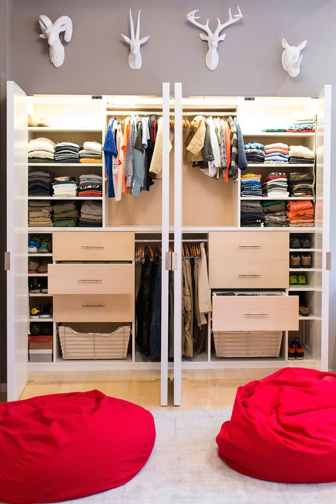 Small trendy gender-neutral light wood floor reach-in closet photo in New York with flat-panel cabinets and light wood cabinets