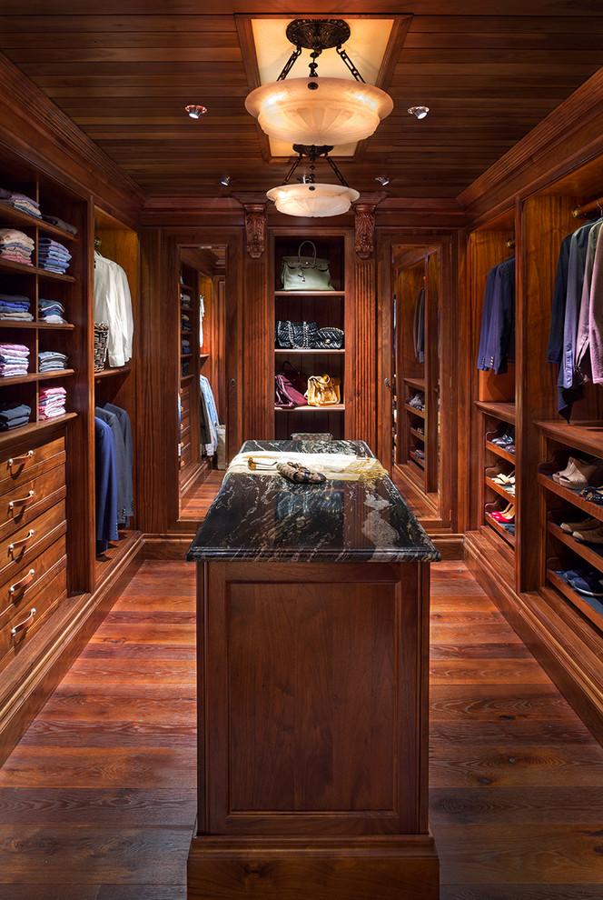 Elegant medium tone wood floor walk-in closet photo in Denver