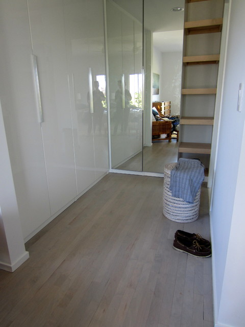 Montauk maple flooring sanded with custom grey stain and Unstained hardwood floors