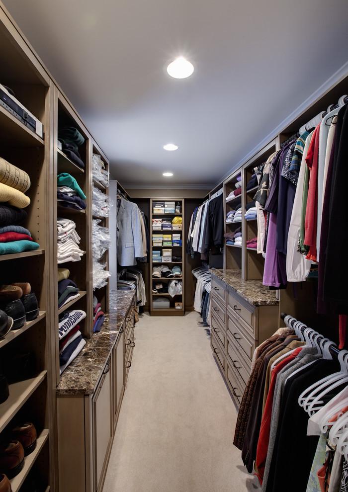 Example of a classic walk-in closet design in Chicago