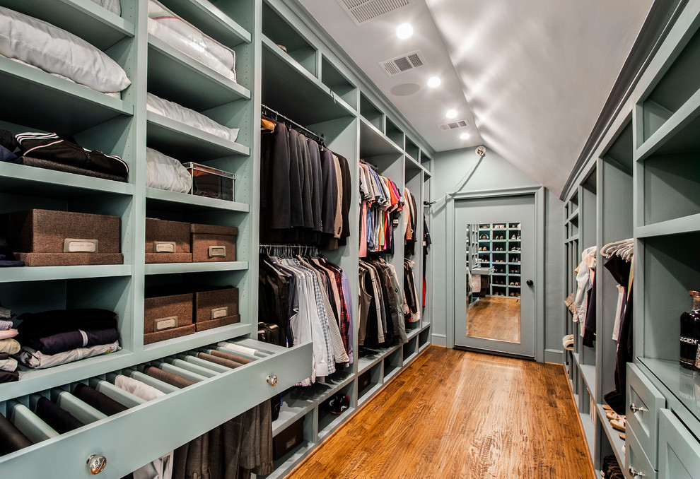 Inspiration for a huge timeless gender-neutral medium tone wood floor walk-in closet remodel in Dallas with open cabinets and green cabinets