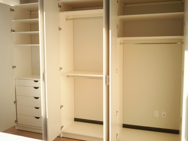 Large Minimalist Gender Neutral Reach In Closet Photo New York With Flat
