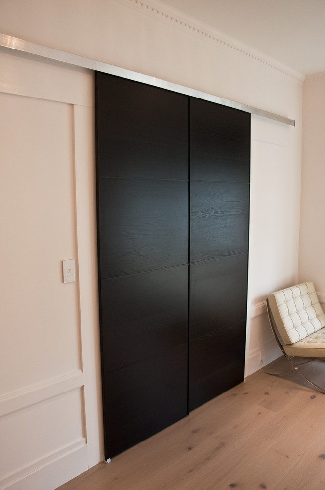 Inspiration for a mid-sized modern gender-neutral light wood floor walk-in closet remodel in San Francisco