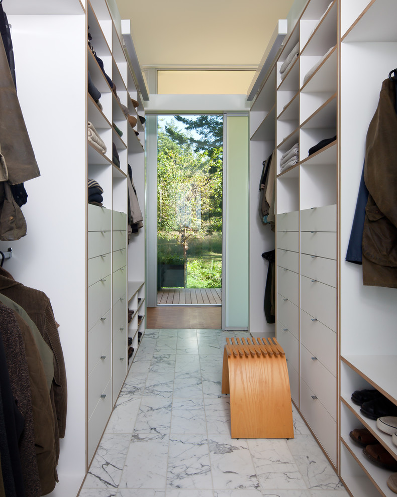 Minimalist men's walk-in closet photo in Seattle with open cabinets and white cabinets