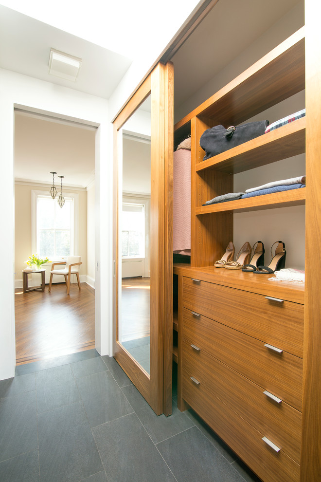 Closet - contemporary women's gray floor closet idea in New York with flat-panel cabinets and medium tone wood cabinets