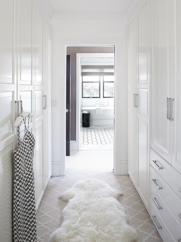 Inspiration for a large transitional women's carpeted walk-in closet remodel in San Francisco with raised-panel cabinets and white cabinets
