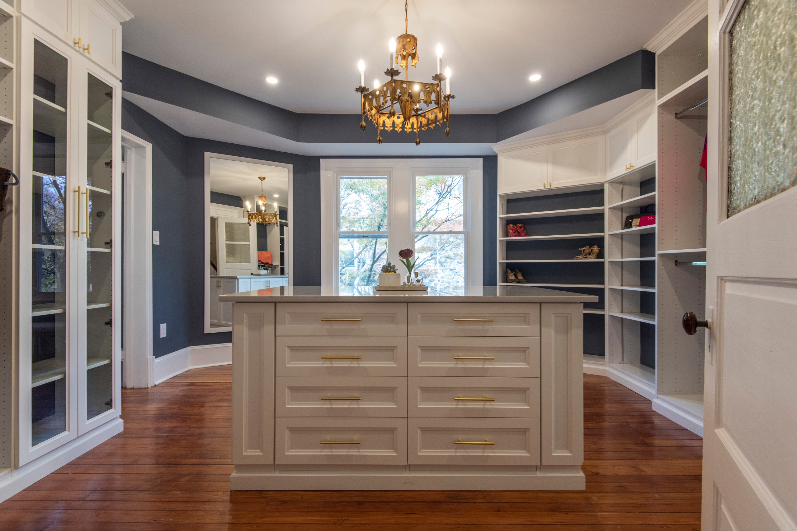 Example of a large transitional gender-neutral vinyl floor dressing room design in Philadelphia with shaker cabinets and white cabinets