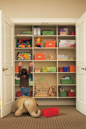 hidden cabinet with several storage bins