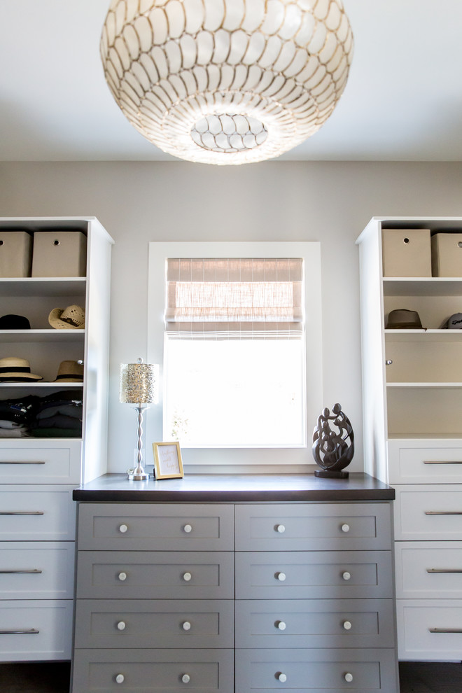 Large transitional gender-neutral carpeted walk-in closet photo in Salt Lake City with shaker cabinets and white cabinets