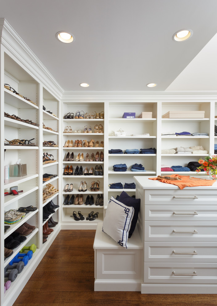 Inspiration for a women's dark wood floor dressing room remodel in Other with recessed-panel cabinets and white cabinets
