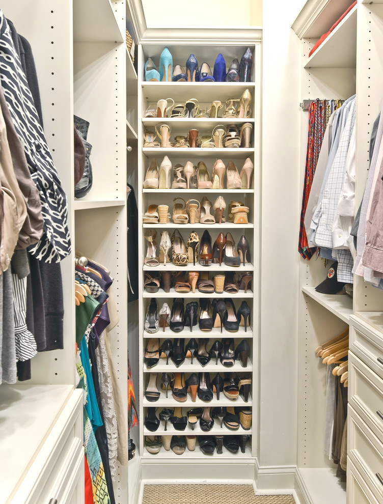 Elegant carpeted closet photo in Cincinnati with open cabinets and white cabinets