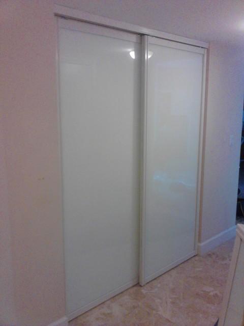sliding doors traditional closet miami by metro door usa. Black Bedroom Furniture Sets. Home Design Ideas