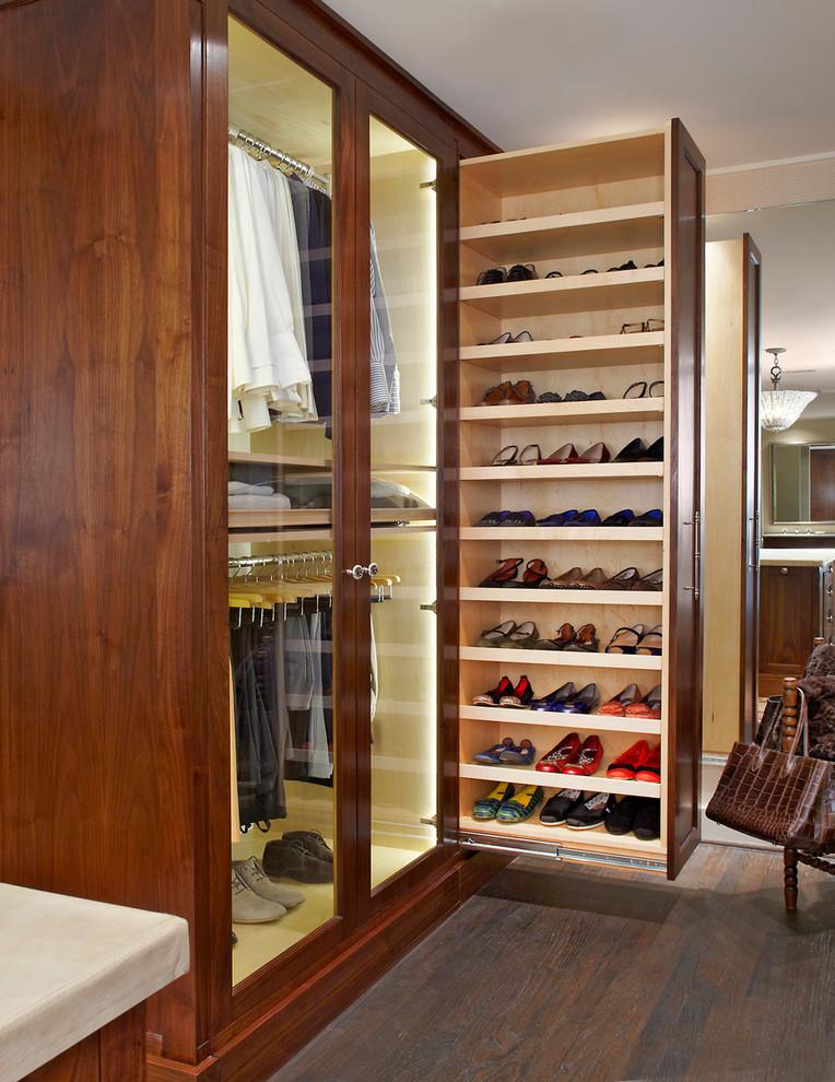 Closet - traditional gender-neutral dark wood floor closet idea in Dallas with dark wood cabinets