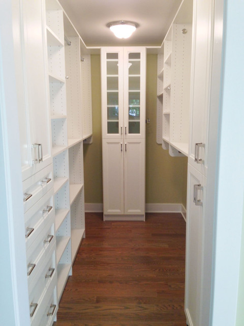 Small walk in closet in white finish and shakers doors - Small closet door solutions ...