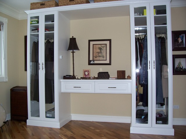 Stand alone cabinets for hanging with makeup area.