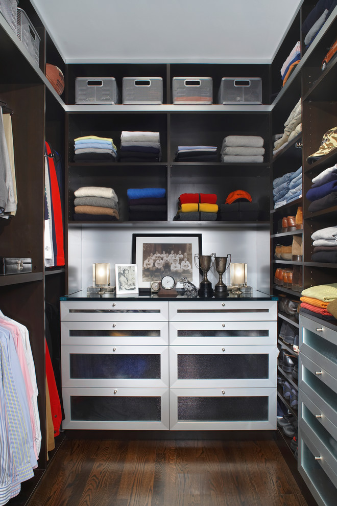 Inspiration for a large contemporary men's dark wood floor and brown floor walk-in closet remodel in Detroit with open cabinets and dark wood cabinets