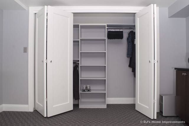 Storage and Closets in Basement by DJs Home Improvements contemporary closet