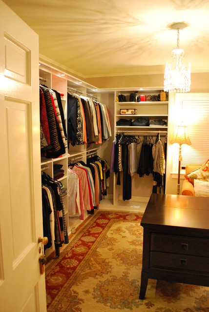 Stunning Women's Walk In Closet with Lighting traditional-closet