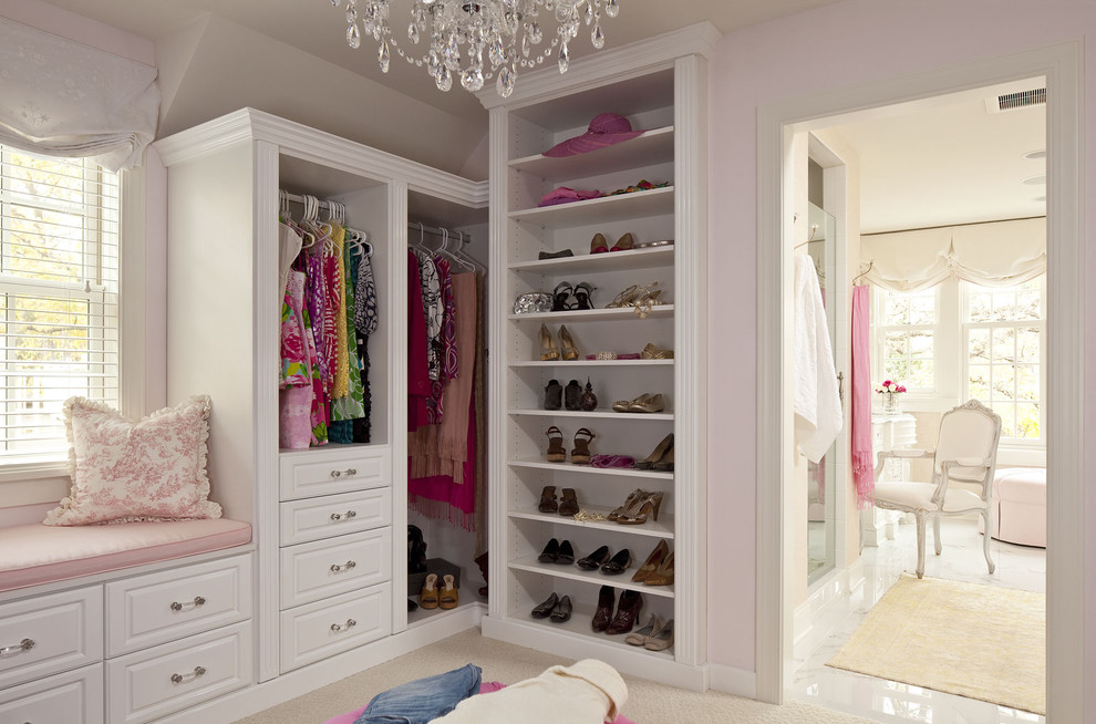 Example of a large classic women's carpeted dressing room design in Minneapolis with white cabinets