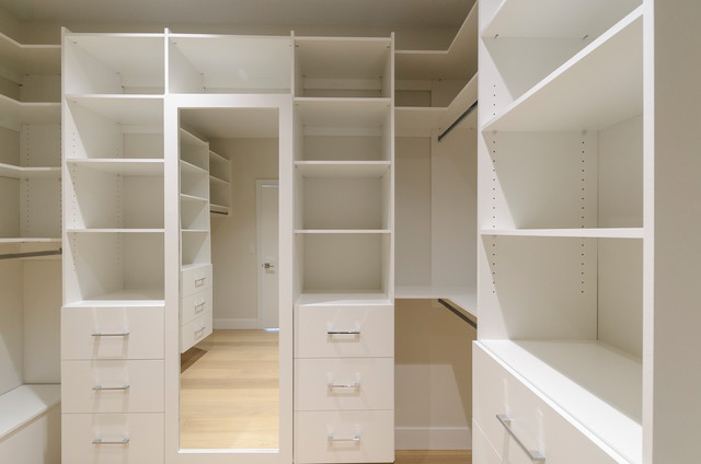 Walk-in closet - large transitional light wood floor walk-in closet idea in Vancouver with open cabinets and white cabinets