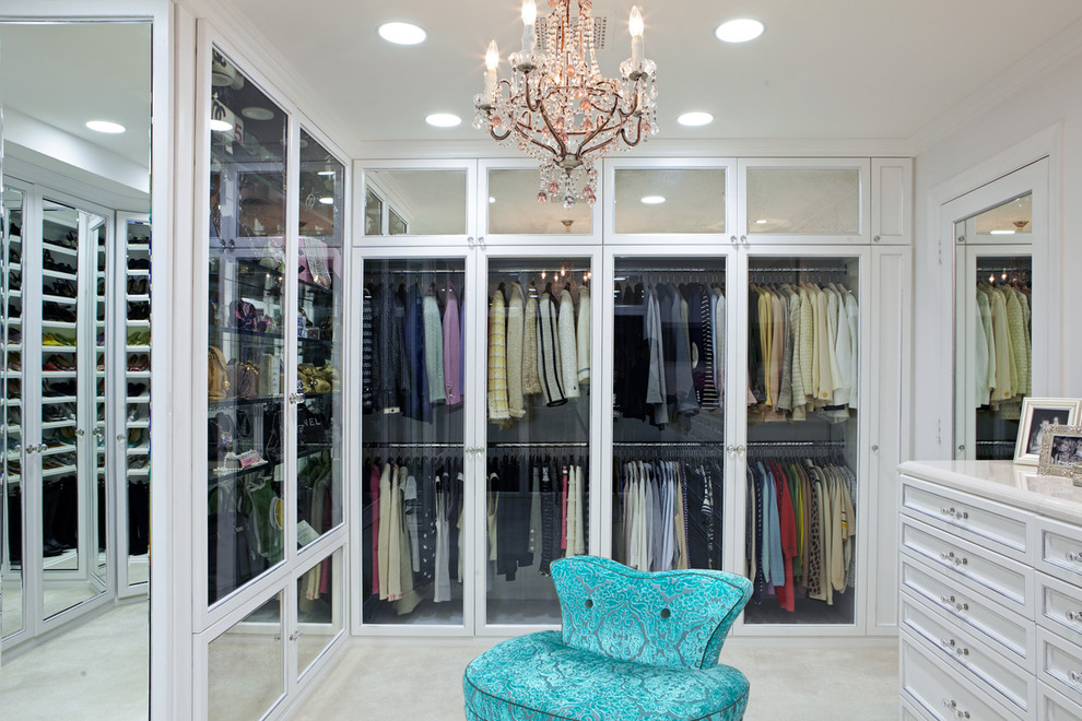 Inspiration for a contemporary walk-in closet remodel in Los Angeles with white cabinets