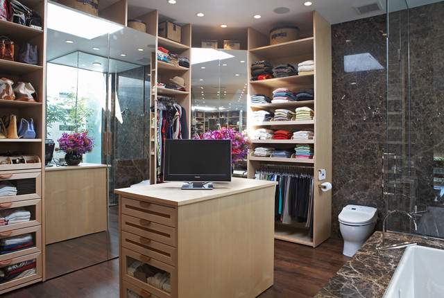 Example Of A Trendy Dressing Room Design In Los Angeles With Open Cabinets  And Light Wood