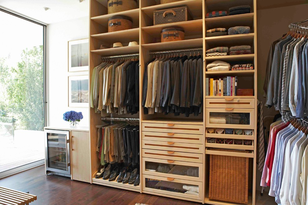 Example of a trendy walk-in closet design in Los Angeles