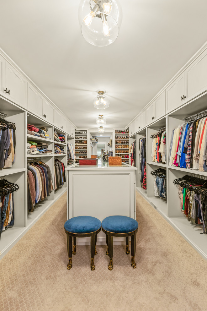Large elegant gender-neutral carpeted and beige floor walk-in closet photo in Cleveland with recessed-panel cabinets and white cabinets