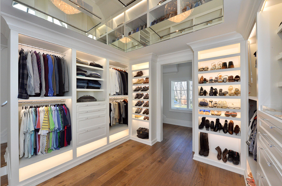 Large transitional gender-neutral medium tone wood floor and brown floor walk-in closet photo in New York with open cabinets and white cabinets