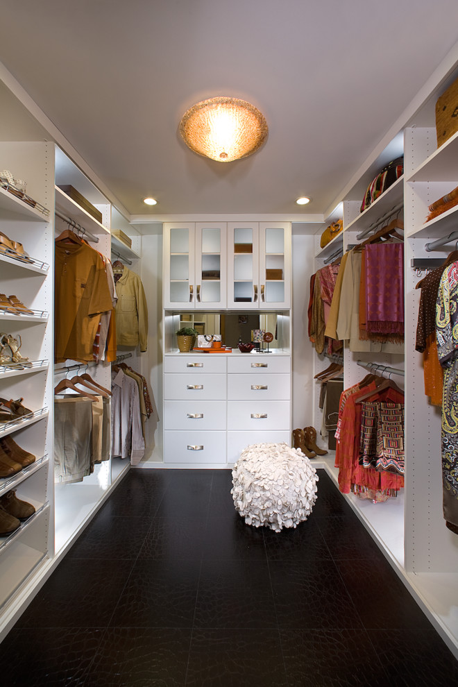 Inspiration for a large transitional walk-in closet remodel in Los Angeles with flat-panel cabinets and white cabinets