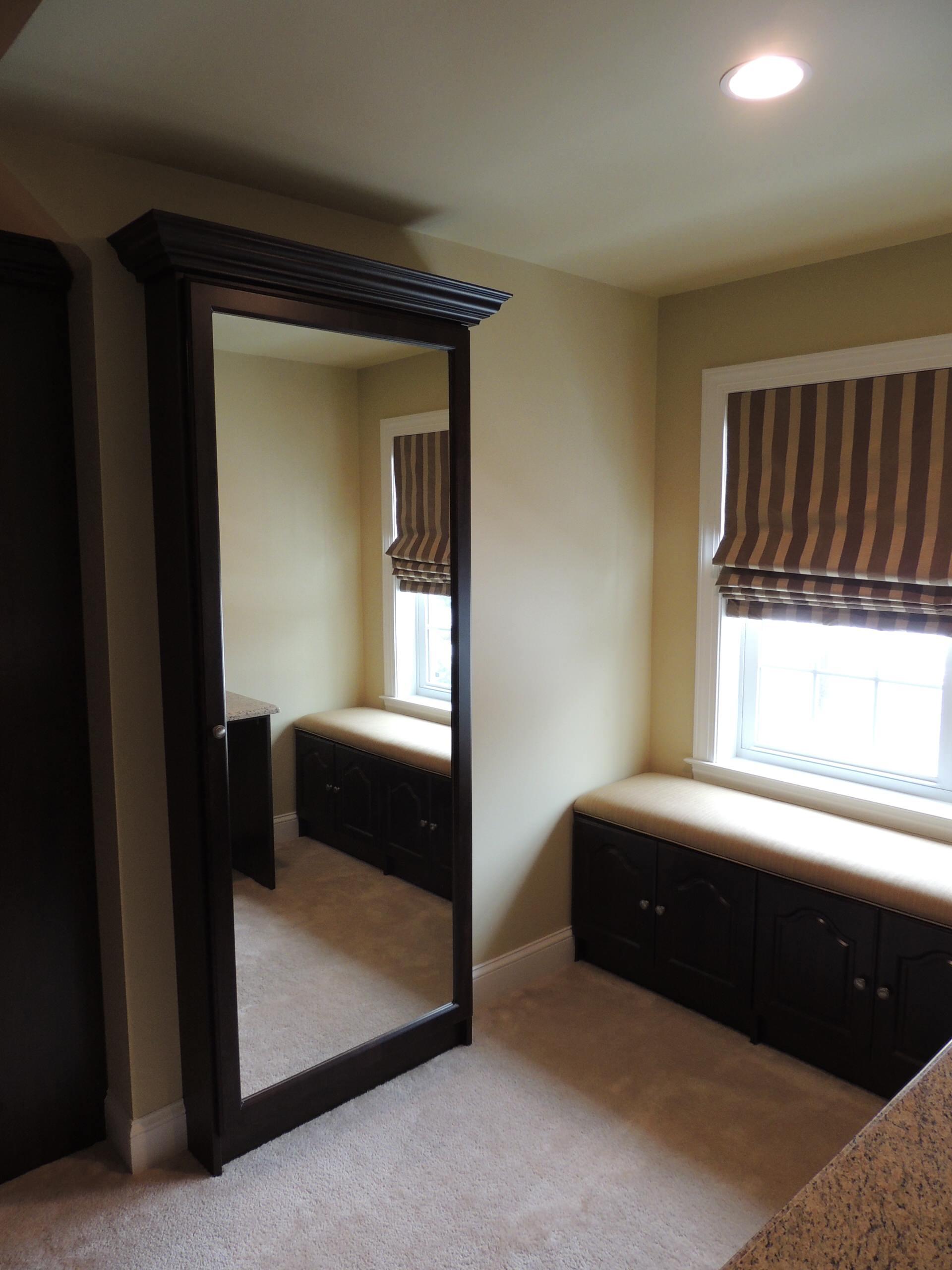 Walk In Closet with Island and Custom mirror unit