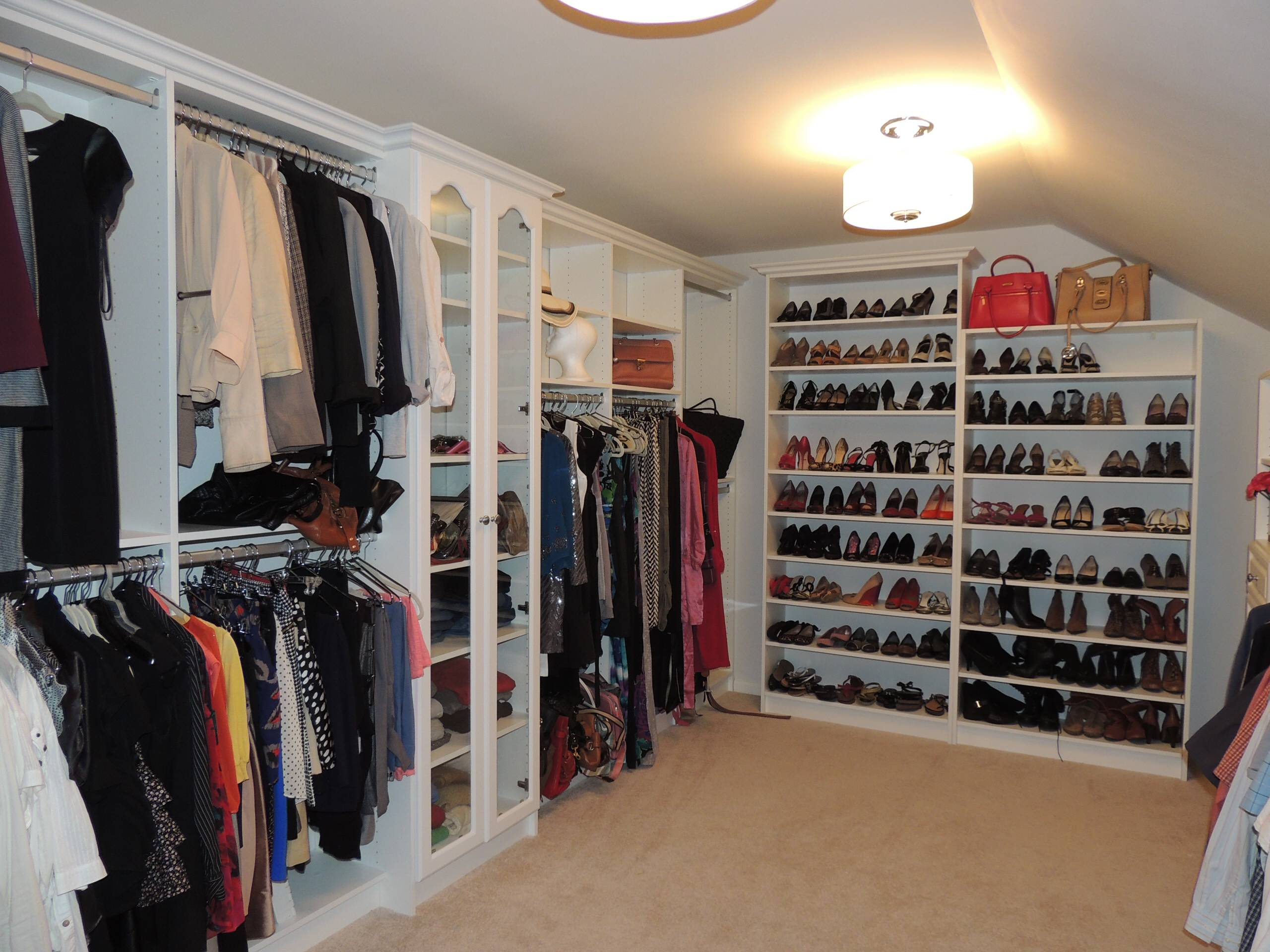 Inspiration for a large timeless gender-neutral walk-in closet remodel in Philadelphia with white cabinets and open cabinets