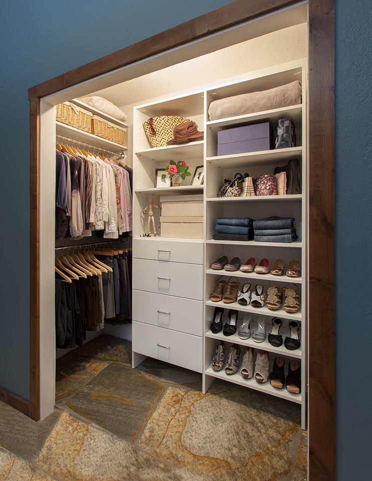 Walk-in closet - small transitional gender-neutral slate floor and multicolored floor walk-in closet idea in Other with flat-panel cabinets and white cabinets