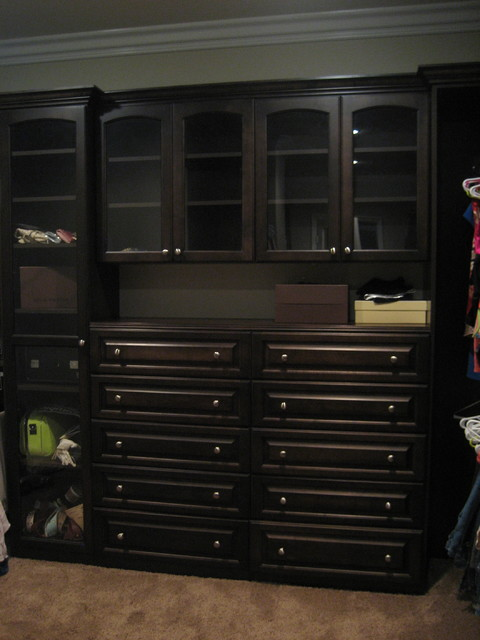 Walk-in Master Closet Chocolate Stained Wood Exteriors and Chocolate Melamine