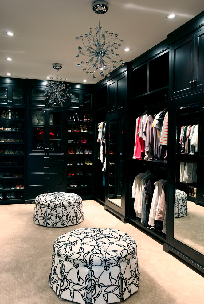Trendy carpeted dressing room photo in Vancouver with black cabinets
