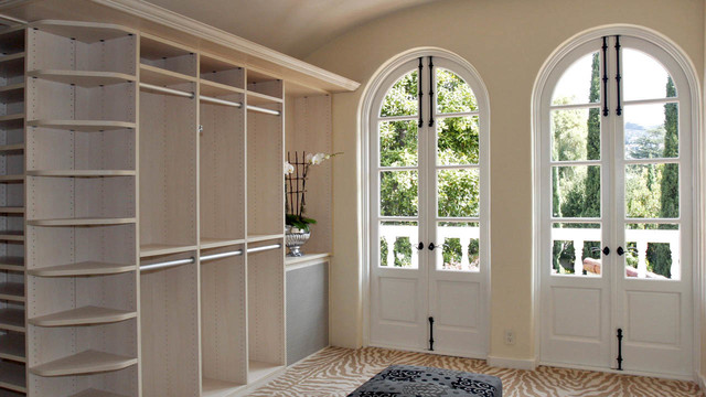 Example of a tuscan closet design in San Francisco