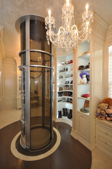 Wood dressing room with pneumatic vacuum elevator for Luxury home elevators
