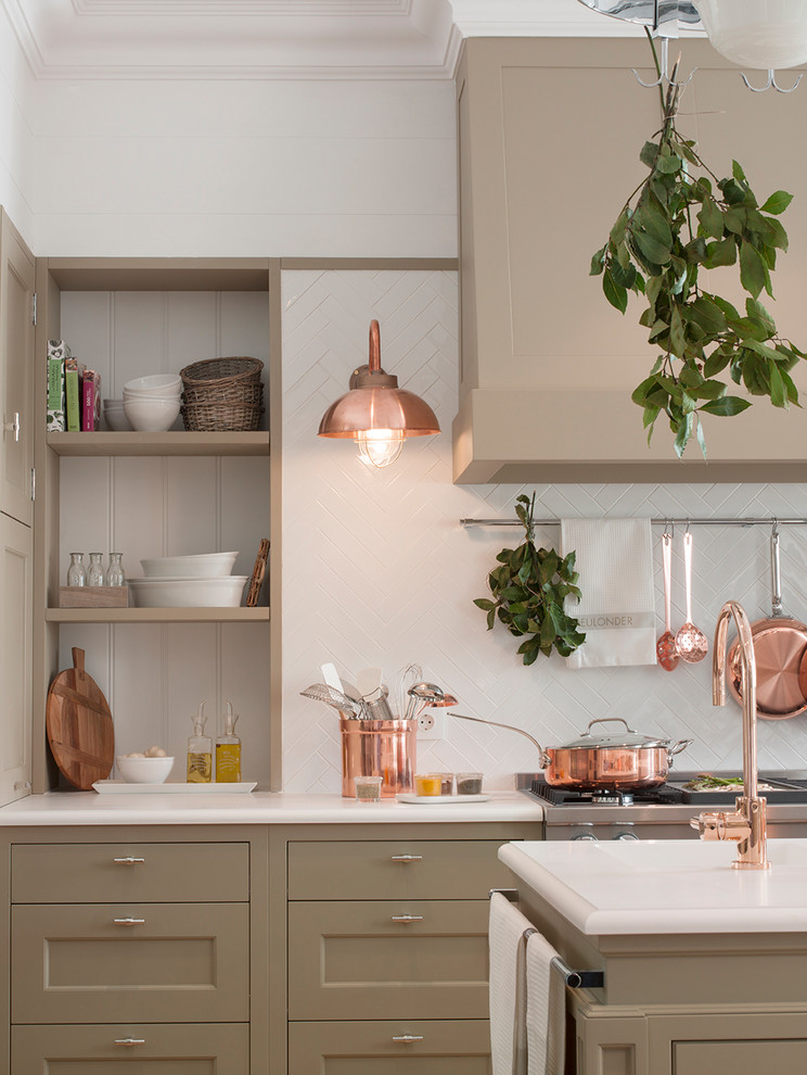 Example of a transitional light wood floor and brown floor eat-in kitchen design in Barcelona with an integrated sink, beige cabinets, quartz countertops, white backsplash, ceramic backsplash, stainless steel appliances and an island