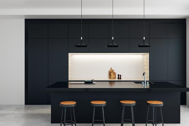 Modelo de cocina de galera, contemporánea, abierta, con encimeras negras, fregadero integrado, armarios con paneles lisos, puertas de armario negras, electrodomésticos negros, suelo de cemento, una isla y suelo gris