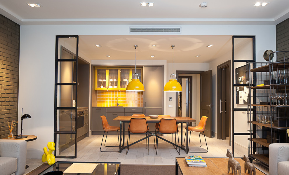 Inspiration for a mid-sized contemporary l-shaped light wood floor eat-in kitchen remodel in Barcelona with flat-panel cabinets, gray cabinets, yellow backsplash, ceramic backsplash and no island