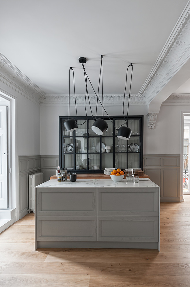Example of a large trendy light wood floor open concept kitchen design in Other with a single-bowl sink, raised-panel cabinets, gray cabinets, marble countertops, white backsplash, marble backsplash, stainless steel appliances, an island and white countertops