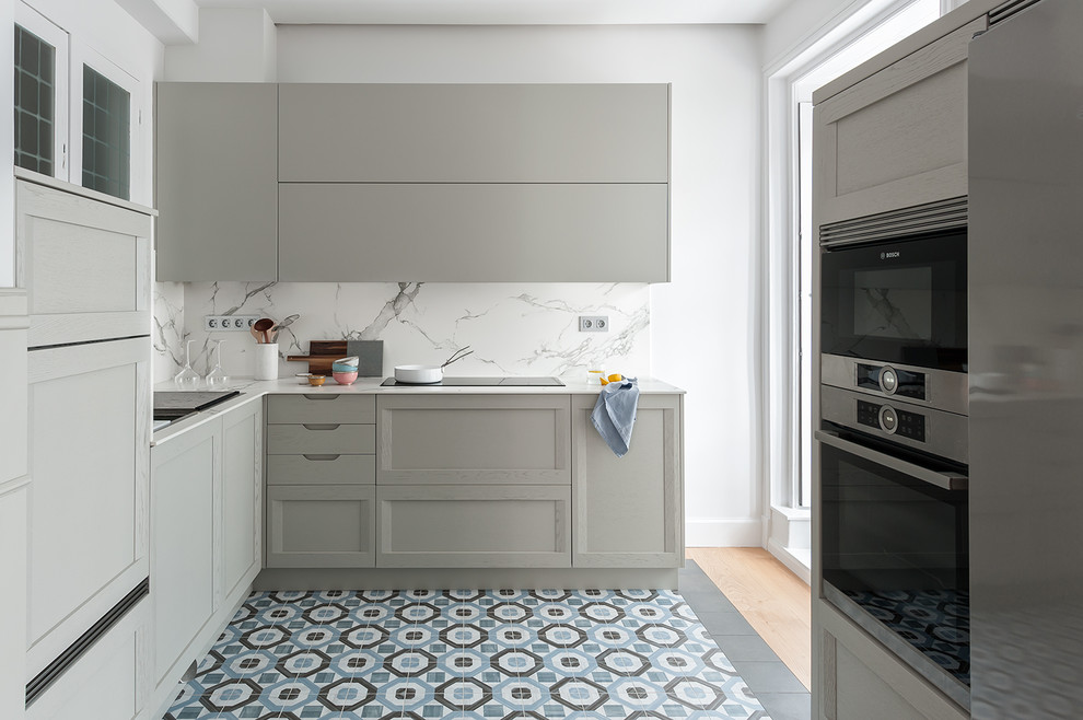 Inspiration for a large contemporary l-shaped multicolored floor and ceramic tile eat-in kitchen remodel in Other with raised-panel cabinets, gray cabinets, marble countertops, white backsplash, marble backsplash, stainless steel appliances, white countertops, a single-bowl sink and an island