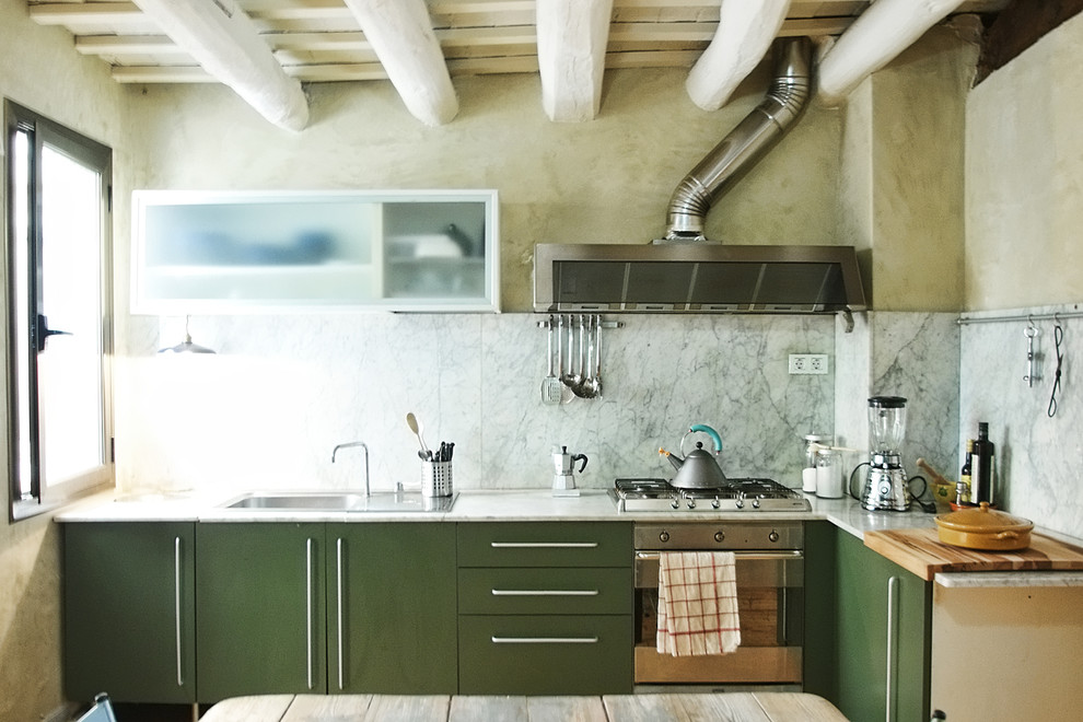 Eat-in kitchen - mid-sized contemporary l-shaped eat-in kitchen idea in Barcelona with a drop-in sink, flat-panel cabinets, green cabinets, marble countertops, gray backsplash, stone slab backsplash, stainless steel appliances and no island