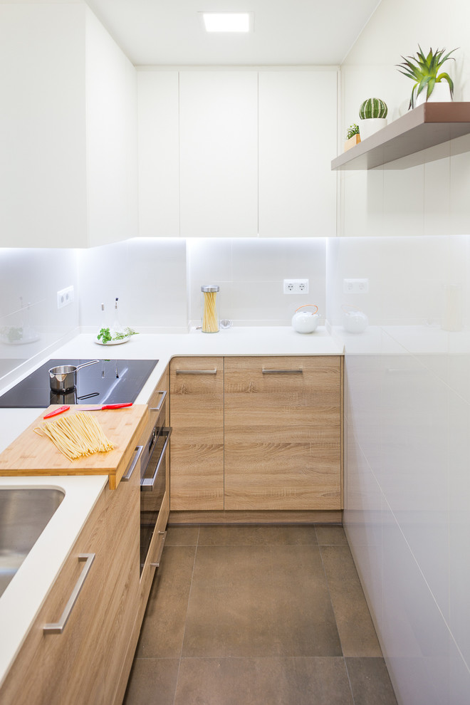 Inspiration for a small scandinavian l-shaped enclosed kitchen remodel in Barcelona with flat-panel cabinets, medium tone wood cabinets, white backsplash and no island