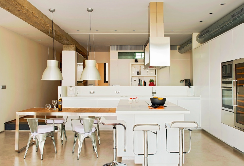 Open concept kitchen - large industrial single-wall concrete floor open concept kitchen idea in Other with flat-panel cabinets, white cabinets, an island, white backsplash and stainless steel appliances