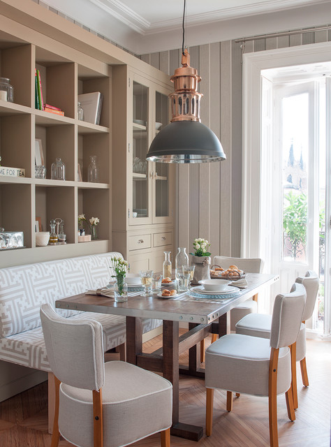 Elegant light wood floor and brown floor kitchen/dining room combo photo in Barcelona with gray walls