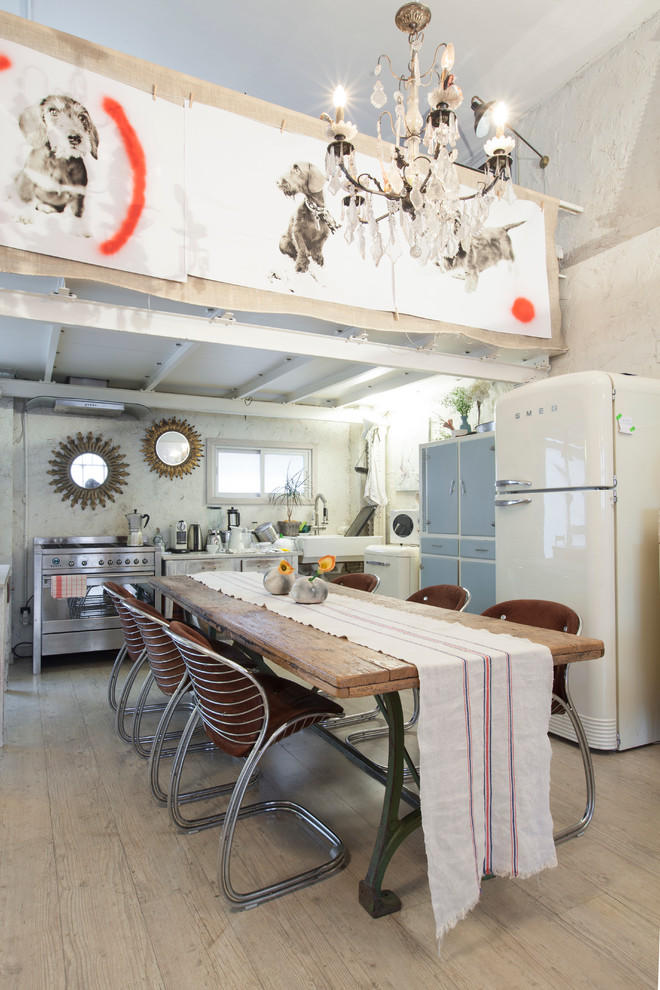 Inspiration for a large eclectic light wood floor kitchen/dining room combo remodel in Madrid with white walls and no fireplace