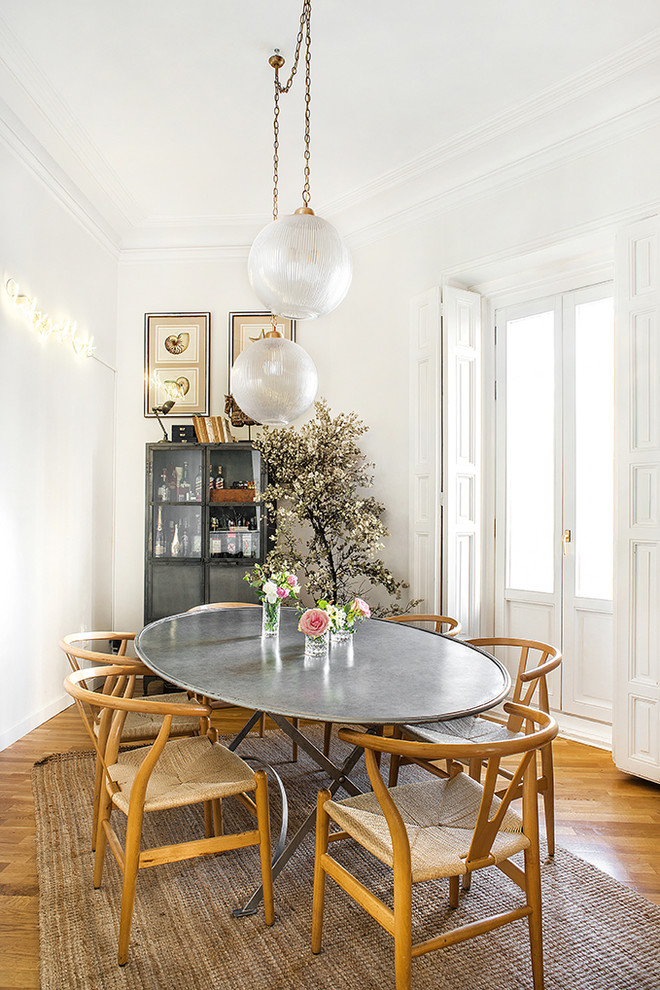Great room - scandinavian medium tone wood floor and brown floor great room idea in Madrid with white walls and no fireplace