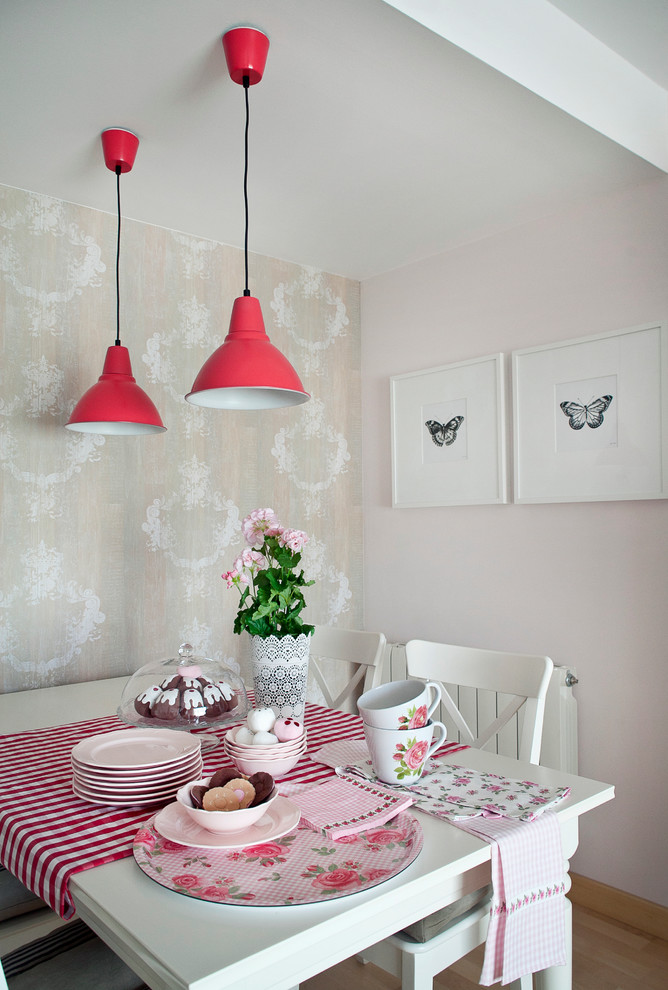 Mid-sized cottage chic light wood floor dining room photo in Other with pink walls and no fireplace